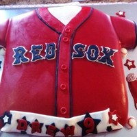 Red Sox Jersey Cake This was a Red Sox Jersey cake used a 12x18 sheet pan and covered with fondant and fondant decorations.