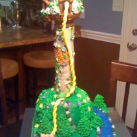 Disney Tangled Tower Cake Disney's Tangled tower cake made for my niece at her request. Tower is made of RKT and is cover in fondant with Royal icing...