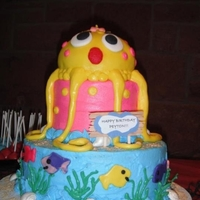 Peyton's Birthday Cake Yellow Octopus on tiered sea scape cake