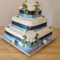 Blue & Black Wedding Cake   14in Cheesecake 10 strawberry 6in Strawberry. Butter cream Flower Gumpaste