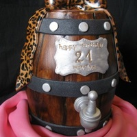 Girly Keg Carved cake, covered in fondant and hand-painted....fondant accents, hand-painted bow