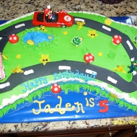 Mario Kart Birthday Mario Kart Birthday cake. Buttercream frosting, fondant decorations and store bought cars