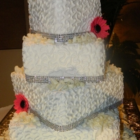 White Chocolate Wedding Cake With Hot Pink Gerber Daisies