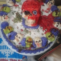 Bloody Skull Cake Solid White chocolate skull with food coloring blood. Cake was a Red Velvet/Vanilla (Dyed green) Marble cake, It looked like a moldy bloody...
