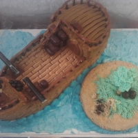 Pirate Ship Cake Arrr! Cannon Balls made from sixlets, cannons made from Tolberon and Peanutbutter sticks. Wheel made from Peanut butter chocolate, parrot made...
