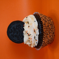 Halloween Oreo Cupcake  I made a dark chocolate fudge cake with an orange Oreo cookie in the bottom of each one. Topped with bc, sprinkles and another Halloween...
