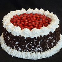 Black Forest Cake  Just a simple black forest cake for a birthday. I filled the inside with three layers of whipped cream frosting and cherry filling. Whipped...