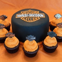 Harley Davidson Graduation Cake  I made this cake and 60 cupcakes for a friend who graduated from motorcycle repair school. It was my first time transferring a logo onto a...