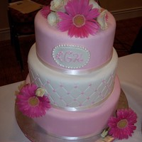 Pink And White Fondant With Fresh Flowers   Display cake for a bridal show. Quilting pattern , white chocolate pearls around monogram and fresh flowers. TFL :)