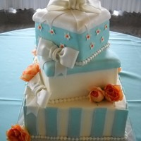 Box Wedding Cake Buttercream frosting with Fondant accents and gumpaste bows with fresh flowers...