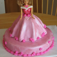 Sleeping Beauty Doll Cake Wonder Mold cake decorated to look like Sleeping Beauty. MMF covered in Pink Pearl Dust.