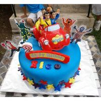 The Wiggles Cake Son's Bday Cake - Chocolate cake with chocolate fudge buttercream covered with Satin Ice Fondant. The Wiggles car, plus the other...