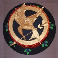 Hunger Games   Cake based on the Hunger Games books. Mockingjay bird is gumpaste painted w/ luster dust. Thanks for looking.