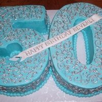 Blue And Silver 50Th   buttercream icing and scrollwork painted w/ luster dust.