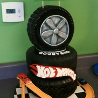 Hot Wheels Birthday This is for my Nephew's 5th Birtdhay party. The track is made from orange modeling chocolate. The tire on the top is RKT. TFL!