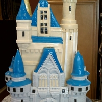 Cinderella's Castle Wedding Cake Made for my friend's wedding! This cake took appox. 30 hours of labor and consisted of DOZENS ofhand made fondant pieces!! So stoked...