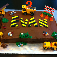 Construction Cake Construction cake for boy's 3rd birthday including a dump truck, bulldozer, power roller, payloader, backhoe, safety cones, edible...