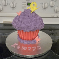 Giant Cupcake Birthday Cake   Vanilla with vanilla buttercream and a candy liner. Accents are gumpaste.