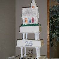 25Th Anniversary Ordination Cake Raspberry filled WASC cake. Church was done with royal icing and rice wafer windows.