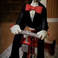Jigsaw From Saw 4' high recreation of the puppet from the movie SAW. All fondant, gum paste, modeling chocolate, sugar cookies and cake. Hand painted...