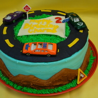 Charles' Cars Banana cake with cream cheese buttercreme. Car themed.