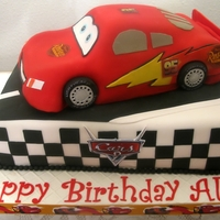 Cars 2 Cake for my grandson's 5th bday. Chocolate cake with raspberry filling. Car is RKT, covered in fondant and edible images.