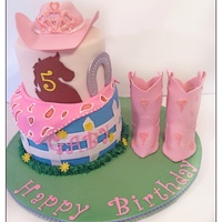 Cowgirl Theme Vanilla cake with cookies and cream filling. Iced in SMBC and fondant. Fondant accents. Gumpaste hat and boots. I enjoyed making this cake...
