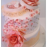 Baby Shower Vanilla cake with fresh strawberries and cream filling. Iced in smbc and fondant. Gumpaste baby and flowers. Cake lace. All edible. The...