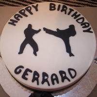 Gerard's Karate Cake   Chocolate sponge with BC frosting and fondant karate men.