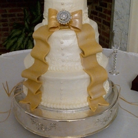 Wedding Cake buttercream frosting with fondant/gumpaste bow and ribbon