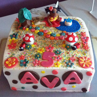 "Fairy Garden 10"" square cake, buttercream with fondant decorations. Covered in edible glitter and pixie dust!"