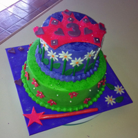 "Rochelle 9""/6"" round, buttercream with fondant decorations. Crown was supposed to stand upright on the cake, but it refused to dry!!"
