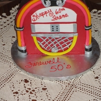 Jukebox Birthday Cake Red Velvet cake covered with modeling chocolate & fondant accents.
