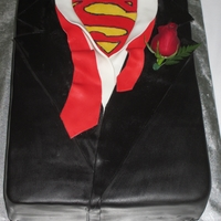 Superman Groom's Cake Chocolate Cake covered in fondant.