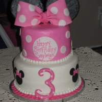 Minnie Mouse Vanilla cake frosted in buttercream with fondant and gumpaste accents.