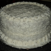 Lemon Coconut White cake filled with Lemon, iced in Buttercream and covered with coconut!