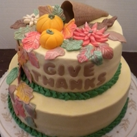 Giving Thanks Buttercream with fondant pumpkins & leaves