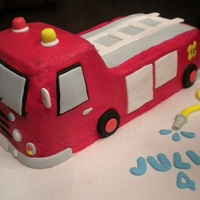 Fire Truck Red buttercream with fondant accents