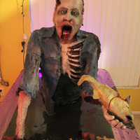 Zombie Cake Fisherman Ted My zombie cake is 25 lbs + of modeling chocolate, 100+ servings of chocolate cake with red colored vanilla buttercream covered in brandy...