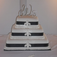 Fleur De Lis Wedding Cake This three tiered wedding cake was for a couple who got married in New Orleans and had their reception later at home. Fondant covered cakes...