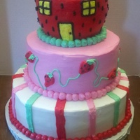 Strawberry Shortcake Birthday cake for a little girl. Strawberry and vanilla cake with buttercream.