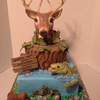 Hunting/fishing Sportsman Cakes Hunting/fishing themed cake. First time using modeling chocolate for the deer and fish. Thanks for looking...