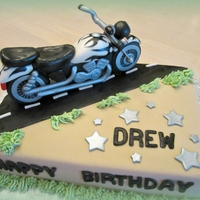 Drew's Motorcycle Birthday Cake   Made for my soon to be son-in-law. Motorcycle made from rice krispie treats and gumpaste. WASC cake with chocolate IMBC and fondant.