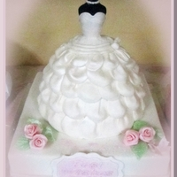 My Daughter's Bridal Shower  Wedding dress is almond cake with almond IMBC covered with fondant to resemble my daughter's wedding gown. The bottom tier is banana...