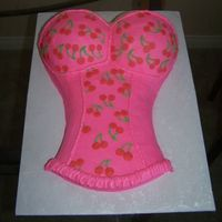 Cherry Corset I wanted the pink to be lighter, but I used the wrong color. Oh well...still turned out cute. It was an 11x15 and two half ball pans with...