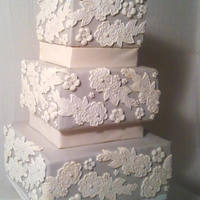 """greige"" And Lace Wedding Cake Greige (Grey & Beige) wedding cake with hand molded lace applique and molded florals and dragee."