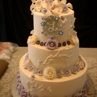 Lilac Roses Wedding Cake 3 Tier buttercream cake designed for a bride for 6/4/11 was completed with less than 6 days notice. All roses are petal by petal...