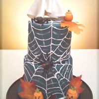 Halloween Web Cake two tier deep dark choc fudge cake with dark chocolate buttercream filling and blue fondant exterior. Embellished with a royal icing web...