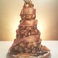 Croquembouche (Done My Way) croquembouche made our way with our specialty orange coconut macaroons, caramel. belgian chocolate, candied pecans and oranges.
