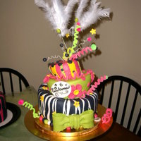 Whimsical Housewarming Cake 3 tier whimsical housewarming cake for 24 year olds who wanted a bright fun cake. 3 whimsical side cakes accompanied this center topsy.
